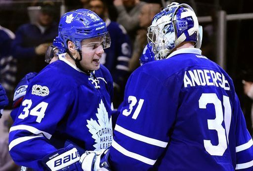 Toronto Maple Leafs goalie Frederik Andersen (31) celebrates the team's win with teammate Auston Matthews (34) following third period NHL action against the Detroit Red Wings, in Toronto on Tuesday, March 7, 2017. (Frank Gunn/The Canadian Press via AP)