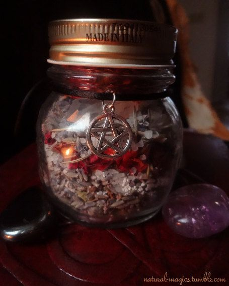 Protection Witch Jar, Ingredients: dried lavender, red rose petals, rose thorns, rosemary, white sage, hawthorn berry, sea salt, bay leaves, black pepper, dragon's blood resin, frankincense resin, myrrh resin, eggshell powder, and a clear quartz crystal. These glass jars are packed with herbs and resins for powerful protection of the home