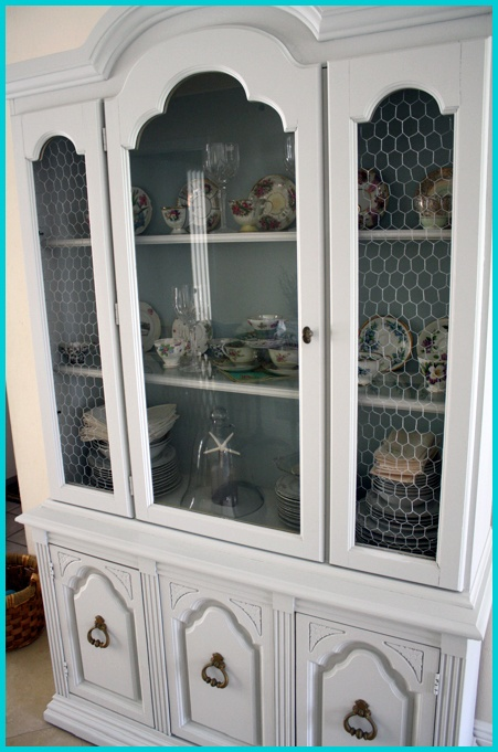 re-done $75 china cabinet. Painted a white/grey and added some chicken wire. Love!