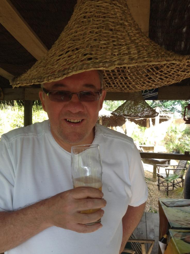 Ian drinking Tusker at Akamba Garden Centre, Dickens Heath