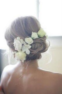 Wedding hair with flowers - bridesmaids!