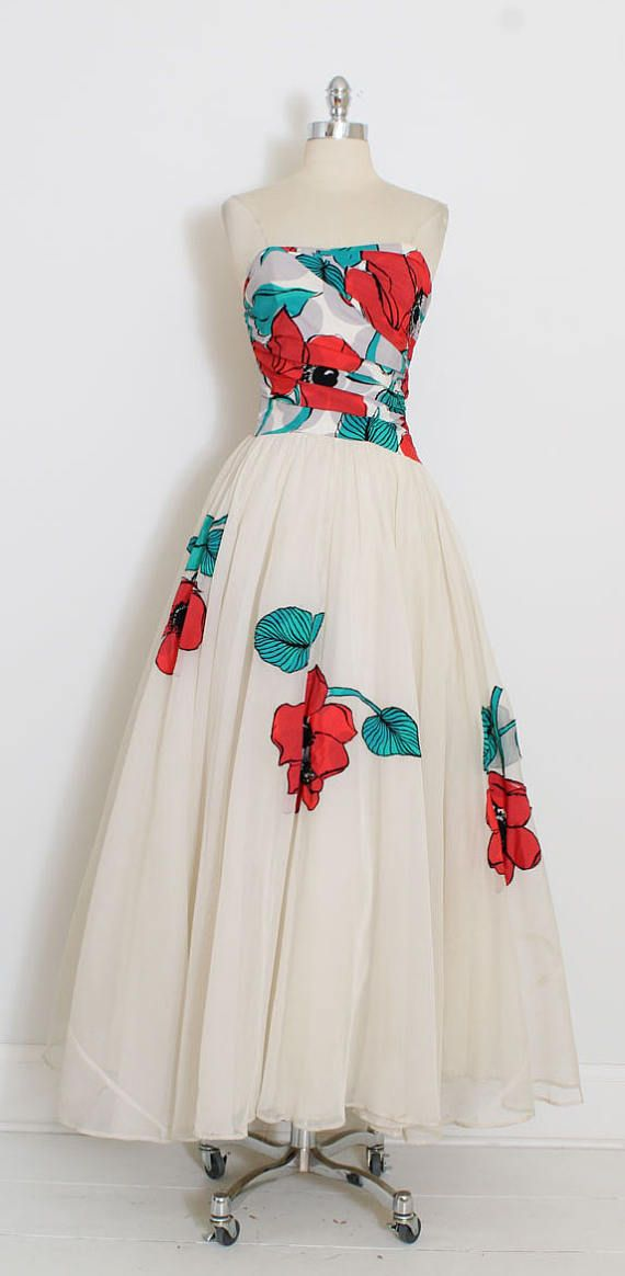 ➳ vintage 1940s dress  * fabulous 1940s gown * vivid poppy print silk crepe * bodice with stays * optional spaghetti straps * mesh acetate and tulle skirt * metal side zipper * stunning and rare style  condition | very good - there is one tiny blue mark at the front center skirt just under bodice. the hem of the dress is lightly soiled due to wear. it could be dry-cleaned or altered/hemmed. still presents beautifully as evidenced by the photos. priced accordingly.  fits like xs/s  l...