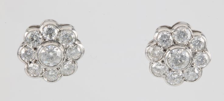 Lot 708a,	A pair of 18ct white gold 9 stone diamond ear studs, approx 2.45ct sold for £1,650