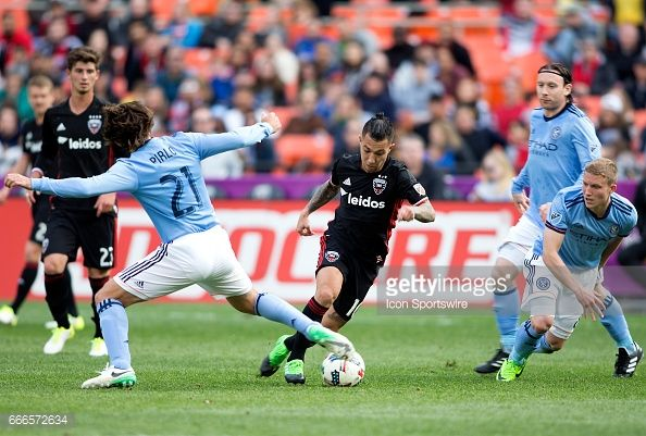 D.C. United midfielder Luciano Acosta (10) dribbles away from New York City FC midfielder Andrea Pirlo (21) during a MLS game between D.C. United and New York City FC on April 08, 2017, at RFK Stadium, in Washington DC. DC United defeated New York City FC 2-1. #DCUnited #DCU #WeAreUnited