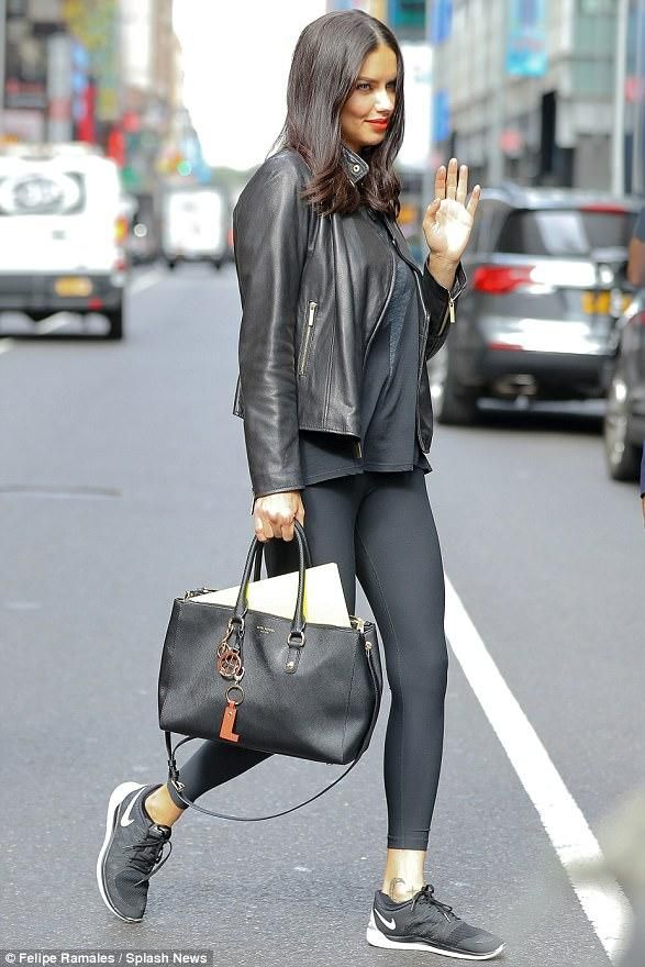 Adriana Lima wearing Nike Free 5.0 Sneakers in Black