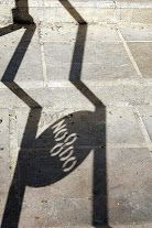 """Sevilla's NO∞DO emblem on the railings leading up Ascent of Mount Gurugú, in Maria Luisa Park. The NO-DO symbol appears in other European cities that had religious significance during the Middle Ages (like London), a Lating acronym meaning """"The name of God"""" (NOmen DOmini). Thus the symbol ∞ sandwiched between these acronyms could be an eternal a knot (nodus in Latin)."""
