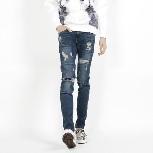 Casual distressed skinny blue jeans.  The ultimate in casual wear, a distressed pair of blue jeans is easy to slot into your weekend wardrobe. Wear these low rise skinny jeans with anything from your band shirts to pullover sweaters for the weekend. The skinny silhouette and the distressed finish make these jeans perfect for street and casual wear.