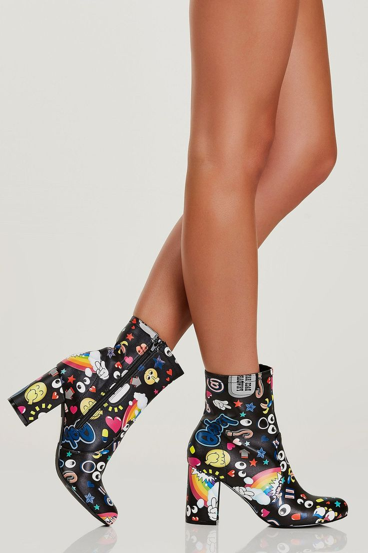 Faux leather above the ankle booties with chunky block heels. Slightly rounded toe with colorful emoji prints throughout and side zip closure.