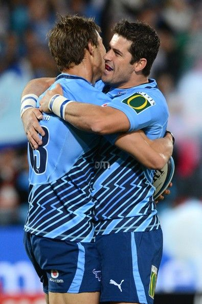 Try scorer JJ Engelbrecht of the Bulls celebrates with Morne Steyn (R) during the Super Rugby match between Vodacom Bulls and Hurricanes at Loftus Versveld on May 04, 2013 in Pretoria, South Africa.