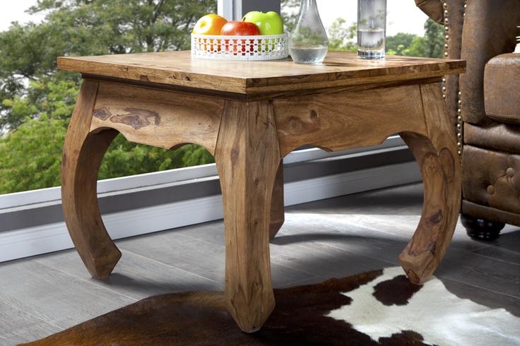"""Dieser formschöne Beistelltisch """"Opium"""" aus massivem Sheesham Holz ist der ideale Tisch für Ihr Wohnambiente. Der Tisch vermittelt ein rustikales Urlaubsflair und überzeugt durch sein naturbelassenes und klares Design. Zu einem charakteristischen Blickfang werden die im asiatischen Stil geschwungenen Beine. Die großzügige Ablagefläche wirkt zudem nie überladen und unterstreicht dadurch zusätzlich den luxuriösen Auftritt. Jetzt bei Riess Ambiente"""