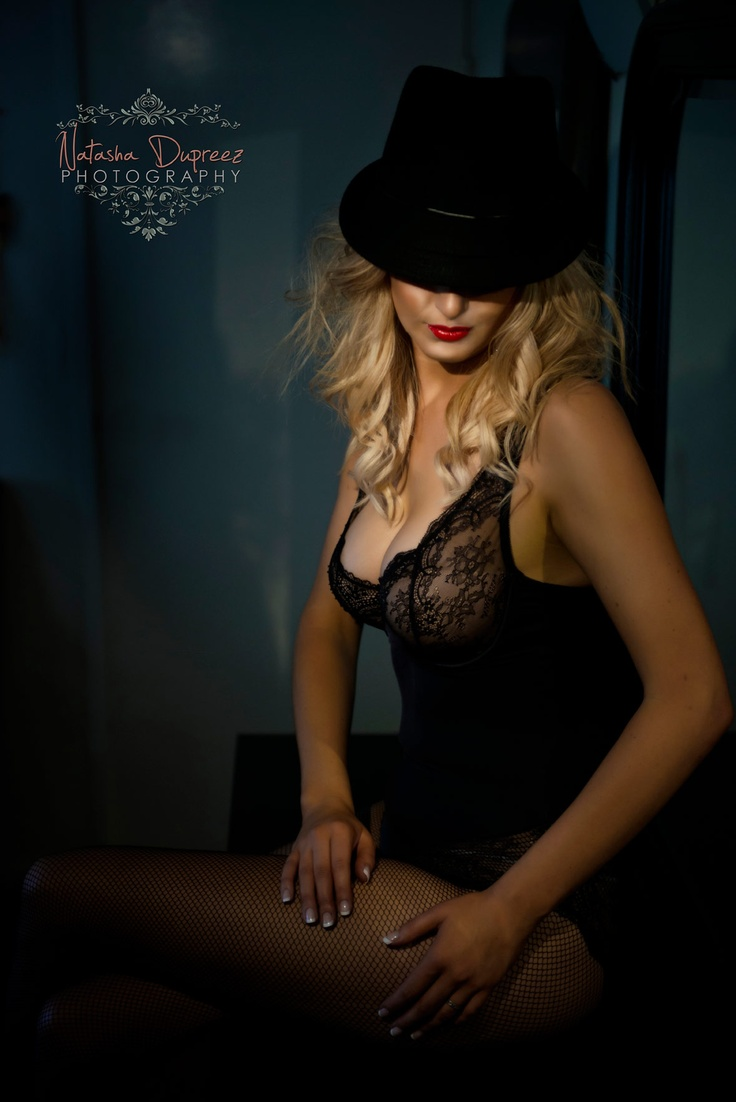 A stunning stylish boudoir photo session done by me. I loved the red lips together with the black hat and lace lingerie and wanted to accentuate the red lips with video light. http://natashadupreez.com.au/