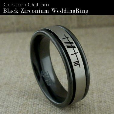 Awesome flat profile relieved black zirconium ring with edge rails and personalized Ogham engraving of your choice. This zirconium wedding ring is available in several width options from 6 mm to 10 mm and 12 mm wide. Whole and half sizes from 4.5 to 15. Comfort fit. Satin or polished finish. Made in the UK by GETi