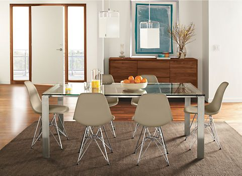 buffet, glass and metal table, leather dining chairs, modern lighting - the chairs would need color in our very white house, but I love the style.