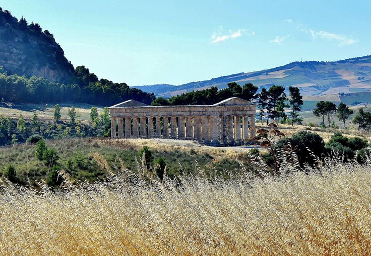 https://flic.kr/p/QaZjv8 | Segesta, Sicily: Greek Temple | Segesta was one of the major cities of the Elymians, a people indigenous to Sicily. The Doric temple was built around 420 BCE; it probably was designed by an Athenian architect and therefore looks just like a Greek temple. Its base, which was built on a platform three steps high, measures 21 by 56 meters, and it has a total of 36 columns--six on the narrow sides and fourteen on the long sides. There is no evidence that there ever…