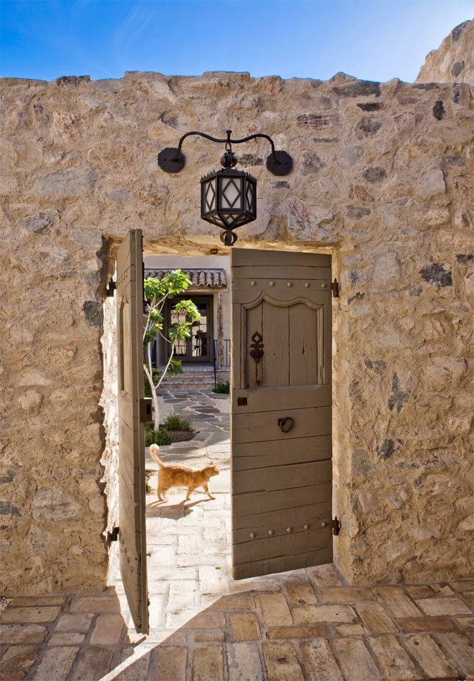 Antique gates in new Tuscan style home