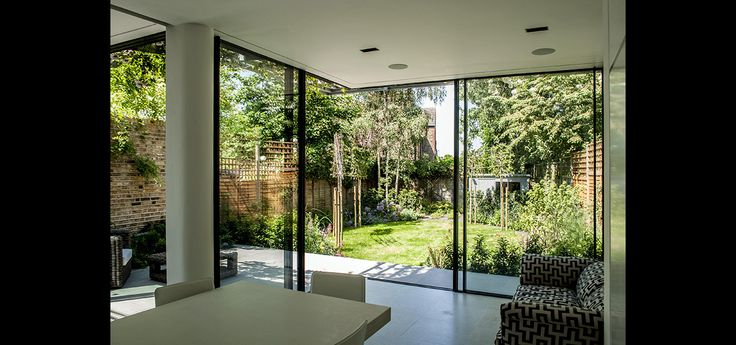 Aluminium framed sliding doors on rear extension opening on corner