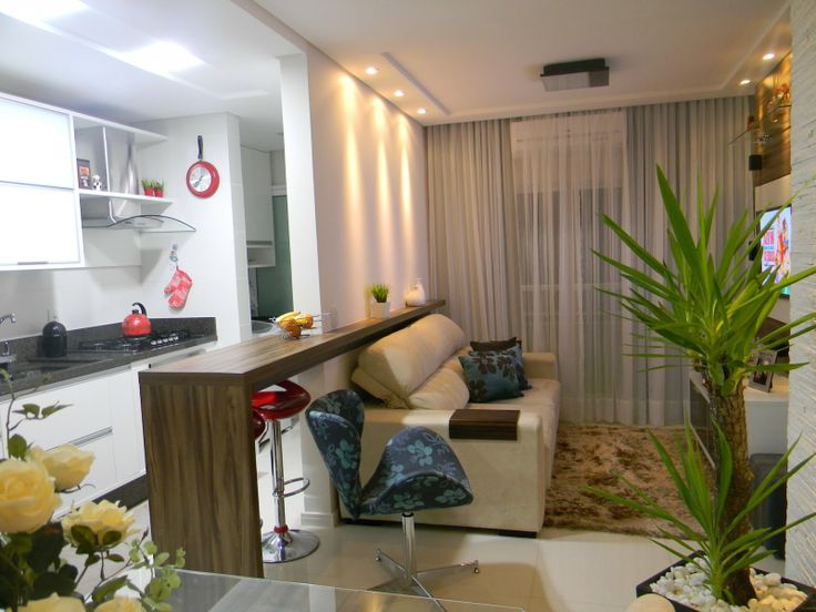 sala interligada a cozinha pela Bancada de madeira