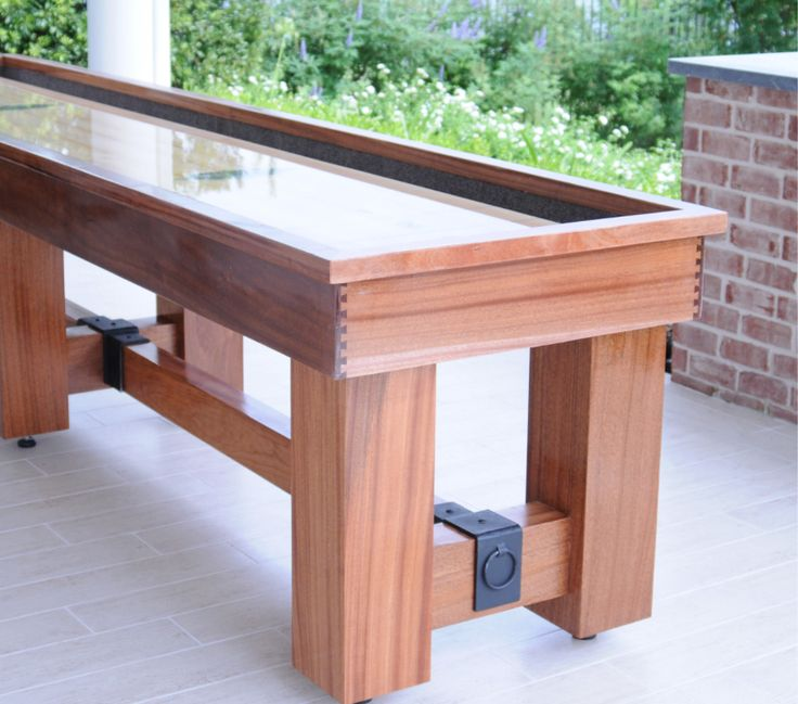 The Aspen Outdoor Shuffleboard Table consist of a water-proof fiberglass sealed playing field made of Hard Rock Maple planks and a solid Mahogany cradle that is prepared to withstand the normal splashes of the outdoors http://www.BilliardFactory.com/Aspen-Outdoor-Shuffleboard-Table