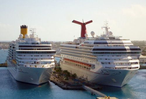 Costa Luminosa and Carnival Conquest in Nassau.  Photo by CruiseReady   #cruise ships#costa Luminosa#carnival conequest#travel#cruising#nassau#bahamas#boats