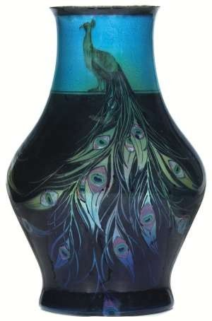 Rare and important Rookwood vase, blue tinted glaze with three peacocks with elaborate feathers that surround the vase, the background band at top has an incised floral design, finely executed by Sara Sax in 1920, #2272, 8 inches wide by 12 1/4 inches high, base drilled for lamp, a fine piece of Rookwood with an unusual design. - See more at: http://www.antiquetrader.com/antiques/antiques-americana/auctions/treadway_gallery_holding_annual_decorative_arts_auction_june_7-8#sthash.nZdOultW.dpuf
