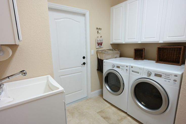 Large Laundry Sink : This large laundry room off of the garage features a laundry sink ...