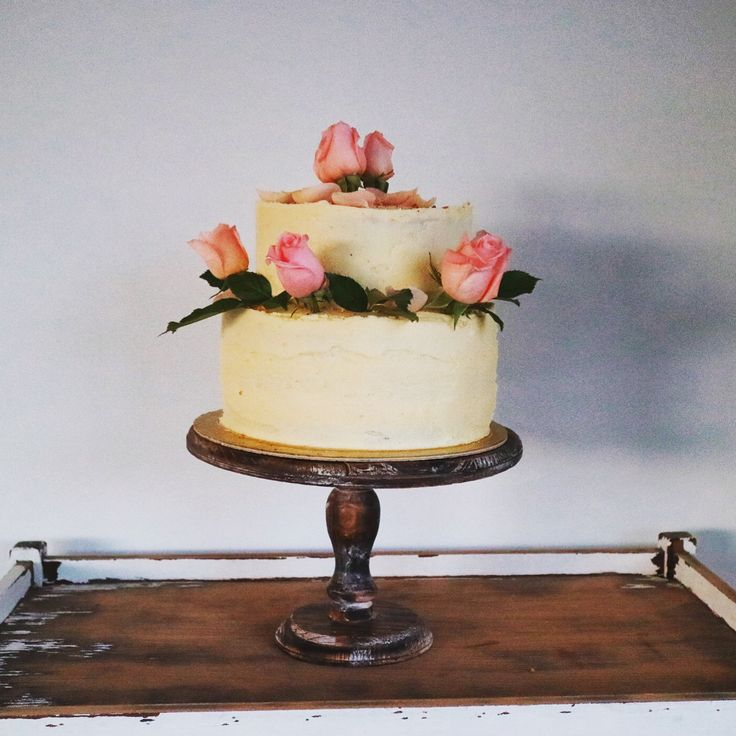 Two-tiered fully iced Wanaka wedding cake with pink roses