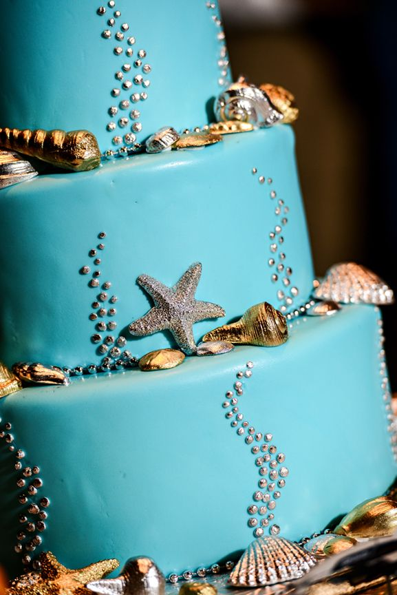 Under the sea inspired beach wedding cake at Walt Disney World