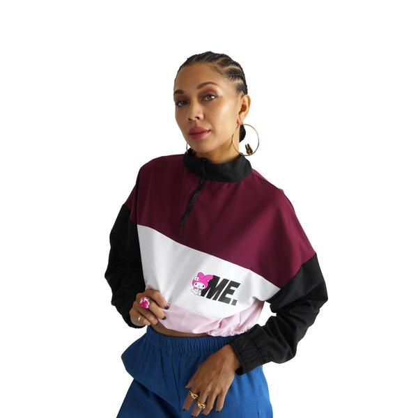 M.E. Windbreaker Long sleeve pullover windbreaker with front half-zip detail and contrast nylon panels. Printed M.E. logo on chest, elastic cording and stopper
