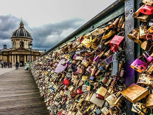 """""""Love Locks"""" on the Archeveche Bridge in Paris, France.  Loved ones hang a lock with their names on it and then throw the key into the river. Even if the relationship ends, the lock cannot be removed and stays forever as a testament to someone once a part of your life."""