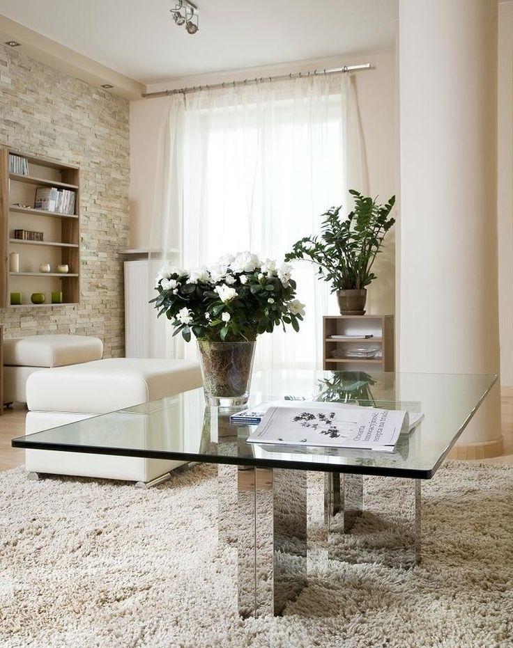 Wohnungseinrichtung Ideen Wohnzimmer Couchtisch Glasplatte Verspiegelte Fuesse