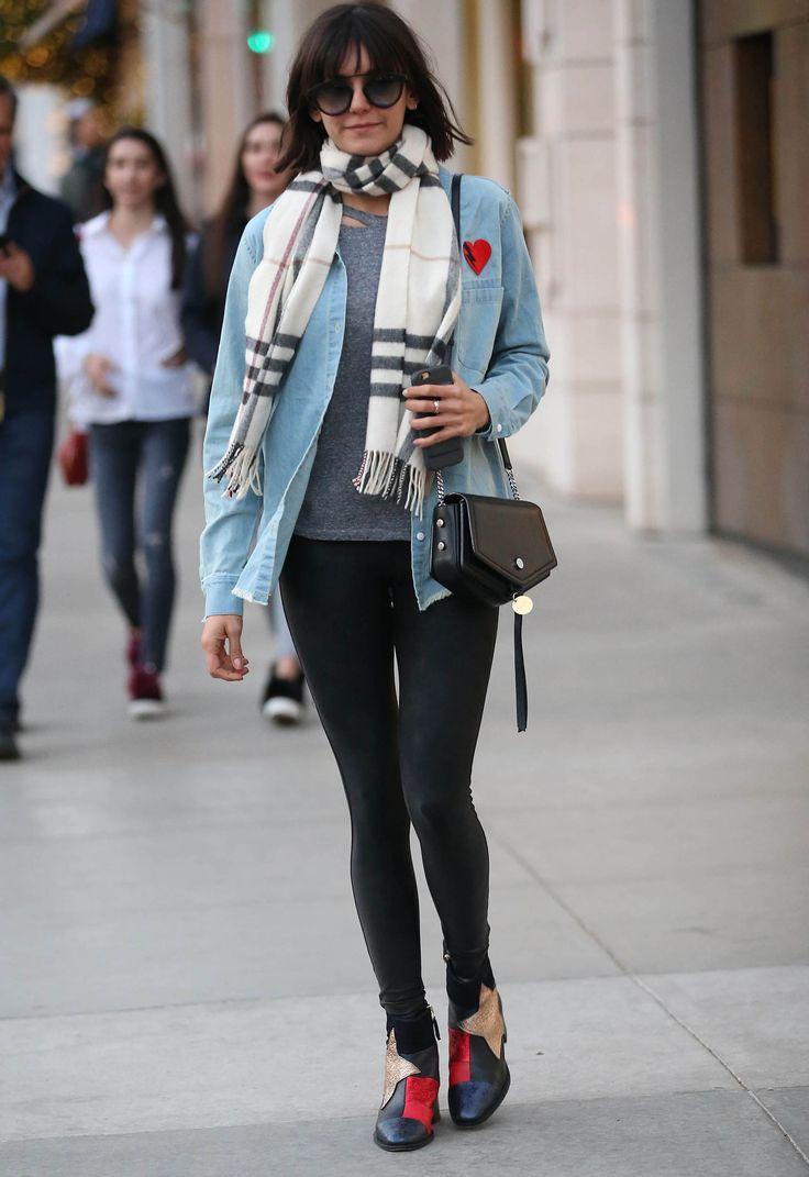 Nina Dobrev wears a denim shirt, leggings, and star patchwork Tommy Hilfiger boots.