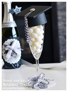 This is such a fabulous idea from Thienly!  She made the cap from the GRADUATION DAY SVG KIT, topping off a champayne glass filled with mints with it!  How cute is that!  Check out her blog to see what other surprises she did!