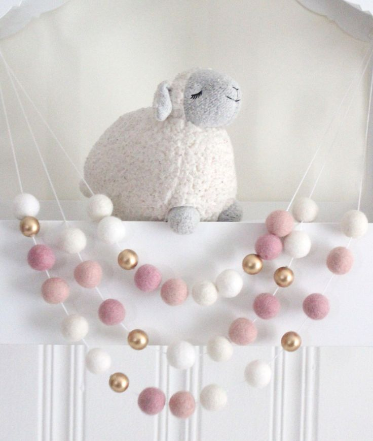 Pink and Gold Felt Ball Garland- Pink Nursery Decor- Gold Accent- Girl Nursery Garland- Pink & Gold Nursery Decor- Felt Balls Wood Balls by SheepFarmFelt on Etsy https://www.etsy.com/au/listing/261752328/pink-and-gold-felt-ball-garland-pink
