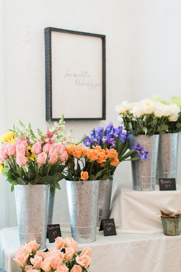 Floral arrangement station: http://www.stylemepretty.com/living/2015/08/07/french-market-inspired-baby-shower/ | Photography: Brooke Images - http://www.brookeimages.com/