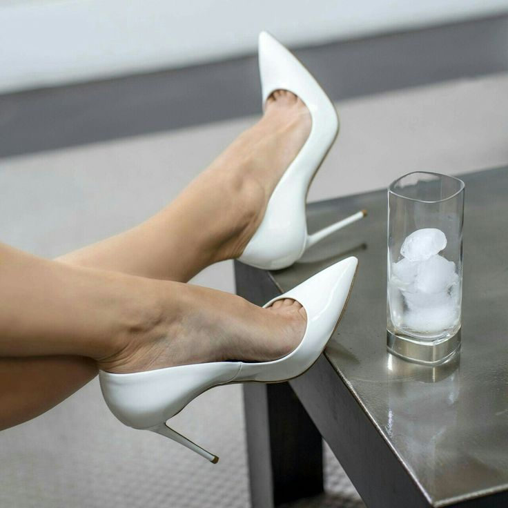 White pumps, toe cleavage, and great legs.   If these are things you like, visit www.bookerpress.com and check out Best Foot Forward.