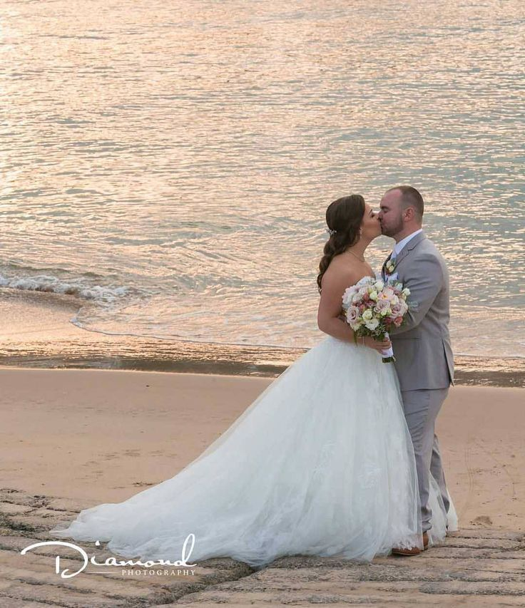 Beach side wedding photography inspiration - bride and groom at sunset
