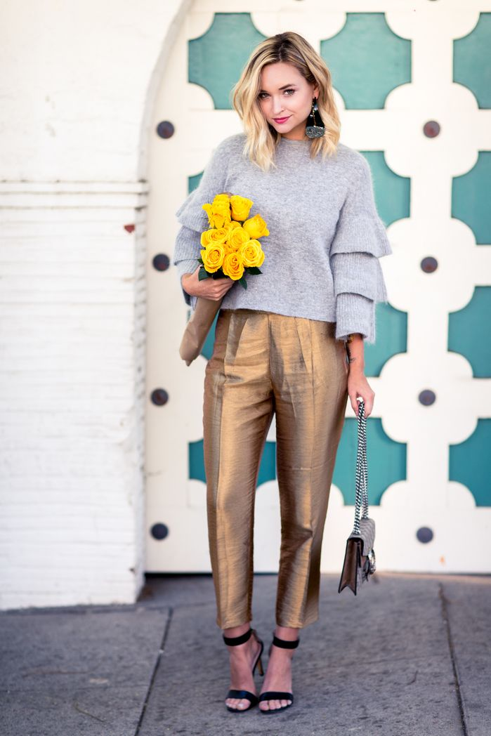 GOLDDIGGER Liz Cherkasova at Late Afternoon: grey woolen sweater, golden metallic pants, ankle-strap heels