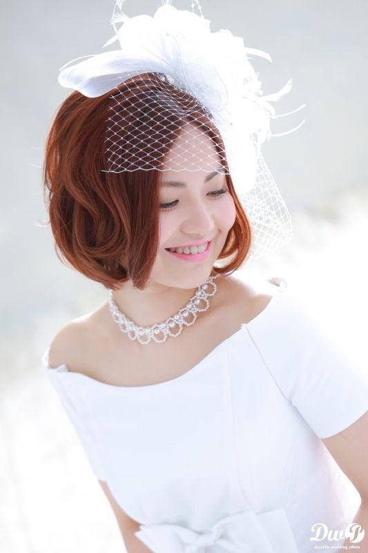 チュールを合わせて女性らしい印象に ウェディングドレス・カラードレスに合う〜ボブの花嫁衣装の髪型まとめ一覧〜