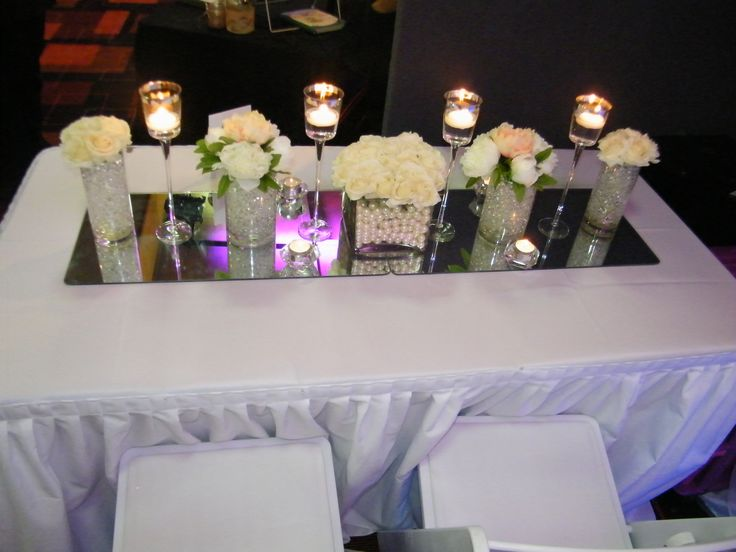 Simple and Elegange Candle lit table arrangements with roses, peonies and floatinh candles - by Toowoomba White Wedding and Event Hire, Weddings, Parties, Corporate Functions {Toowoomba, Surrounding Areas}