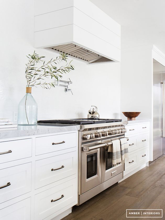 Grey marble kitchen in a lovely light-filled beach home. Photo: tesse Neustadt. Interior: Amber Interiors.