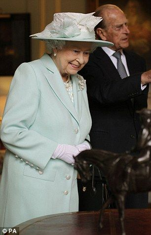 Enjoying herself: The Queen appeared particularly enamoured with the bronze of Macaroni she was introduced to the experts on the antiques roadshow who were filming a episode of the show at hillsborough castle