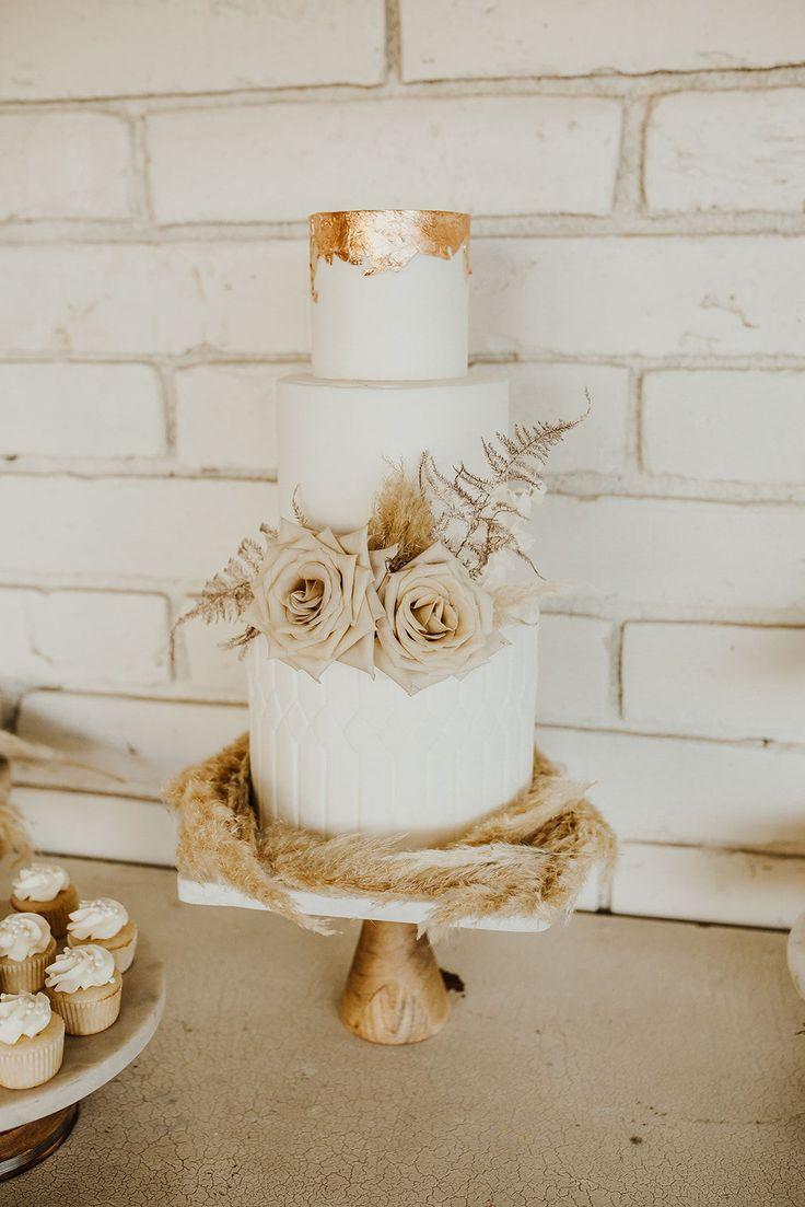 Gorgeous wedding cake with copper leaf, pampas grass, roses and ferns #cakeinspiration #pampasgrass #copperleaf #cake #weddingcake #cakeinspo PC Jennifer Colony Photography | Florals: I Do Rentals AZ | Cake: Amour de Sucre AZ