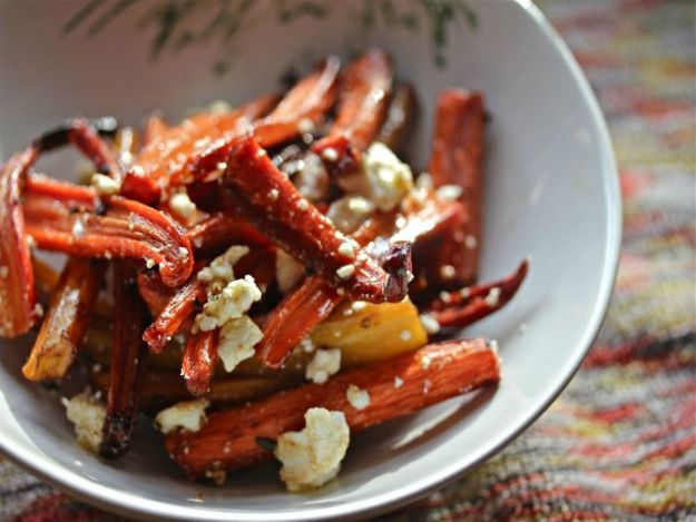 Caramelized oven-charred carrots are finished with tangy feta for a refreshing change of pace.