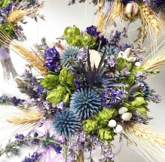 Preserved hops, dried blue globe thistle/ echinops, dried purple larkspur, dried nigella pods, dried strawflower and plenty of pretty accents. Available in this collection: Bridal bouquet $195 Bridesmaid bouquet $65 Boutonniere $15 Corsage $30 Crown/ halo, as shown $65 adult, $45 child Hairpiece/ comb $35  This design will last as a keepsake. You may either purchase directly from this listing, or request a custom collection with the arrangements you need. Please include the date you need to…