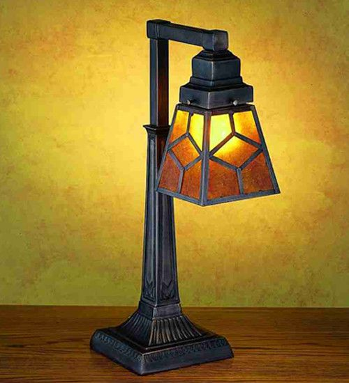 A handsome mission style shade with Diamond pattern,glows with Amber Mica panels…
