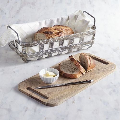 Rolls, fruit or bread—our rustic basket can hold them all and comes complete with a mango wood serving board.