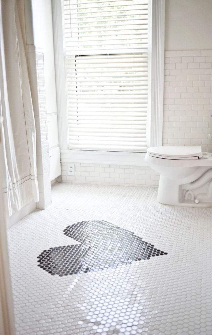 Black and white honeycomb bathroom floor tile! With a heart. A Beautiful Mess