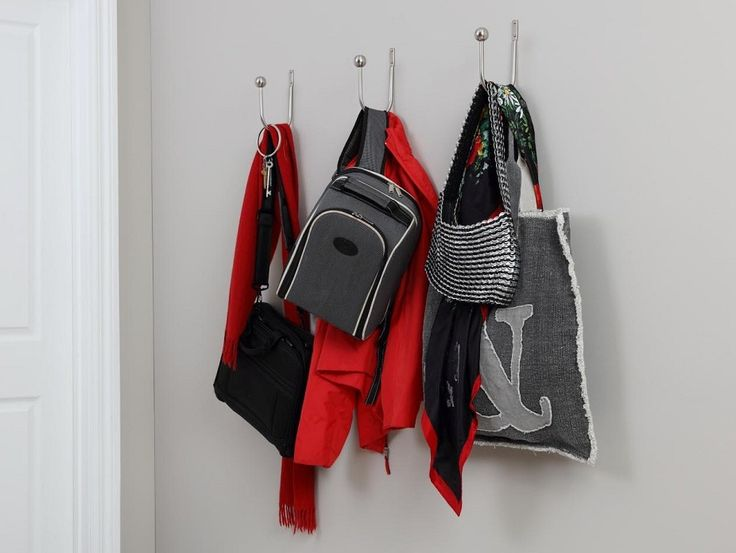 Hang three Poles Apart Satin Silver Ball Holdbacks vertically in the hallway to create the perfect place to hang coats and bags