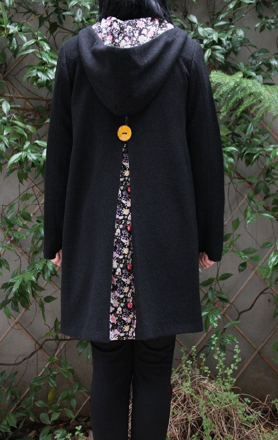 "Black hooded coat with a pleat on the back with flower print, by ""Eating The Goober"""