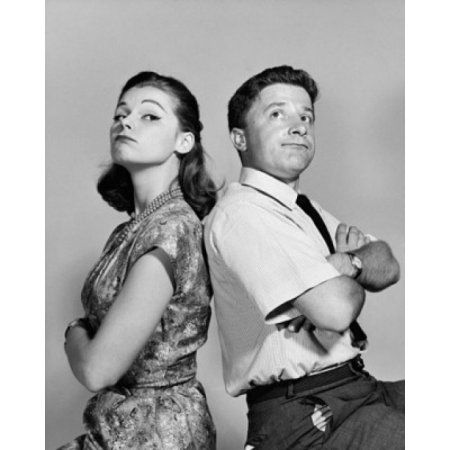 Young couple sitting back to back with their arms crossed Canvas Art - (24 x 36)